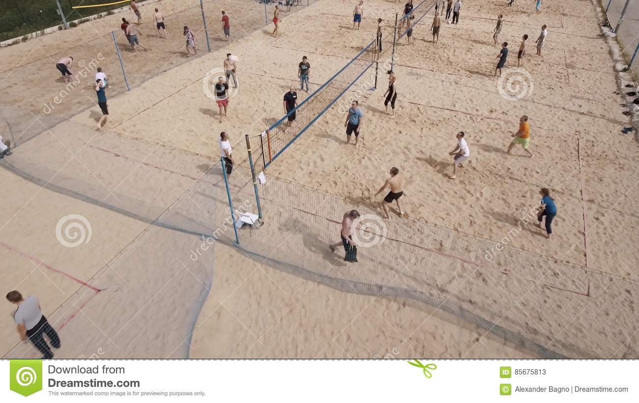 Aerial Shot People Playing Beach Volleyball At Sand Sports Ground On Sunny Day Stock Video