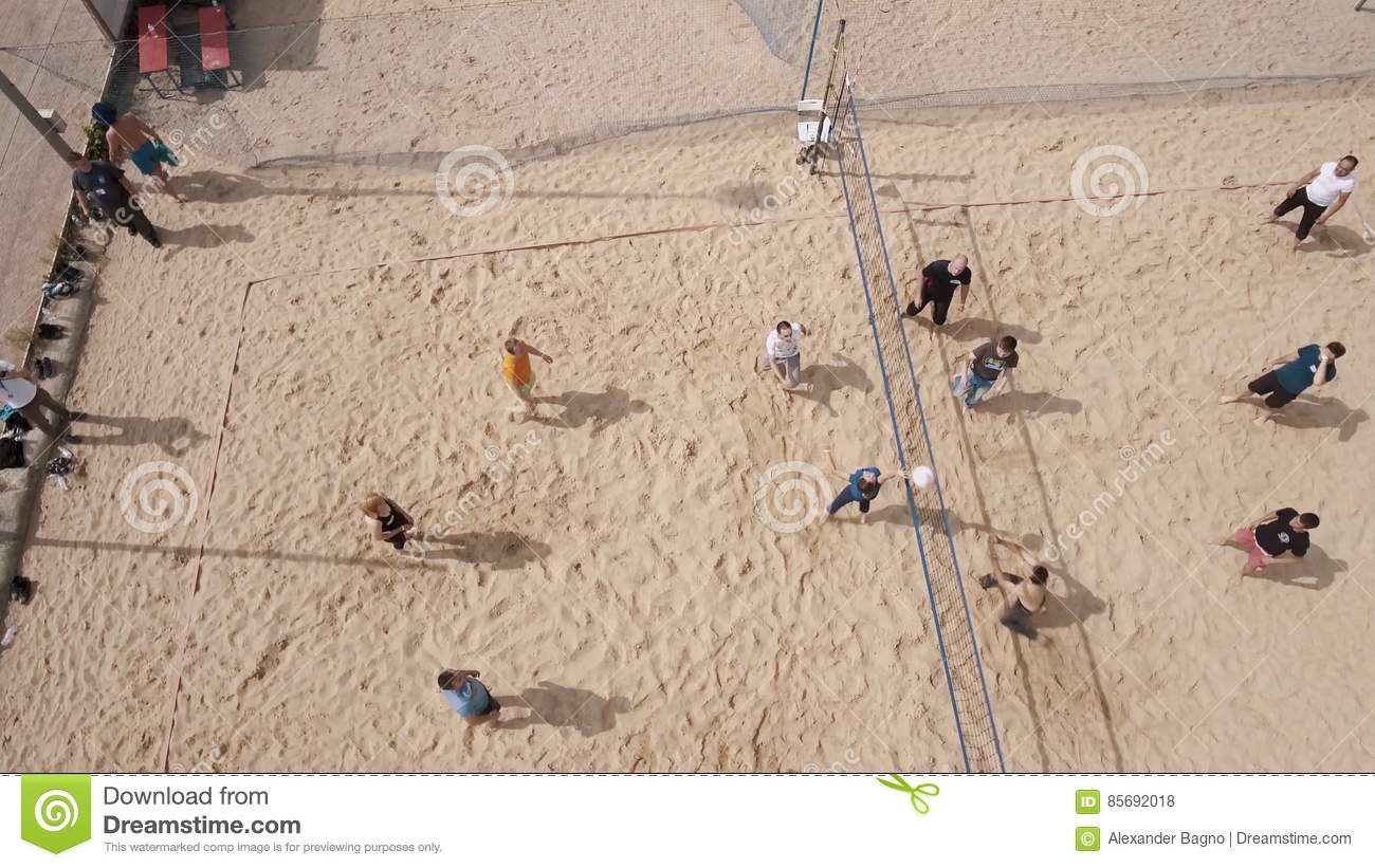 Aerial Shot Young People Playing Volleyball At Beach Sports Ground Sunny Day Stock Footage