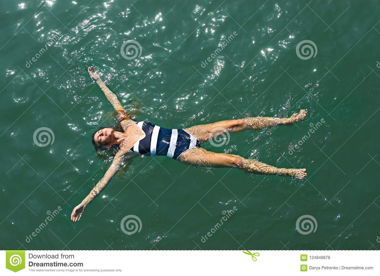 Aerial top down view of a girl in the sea
