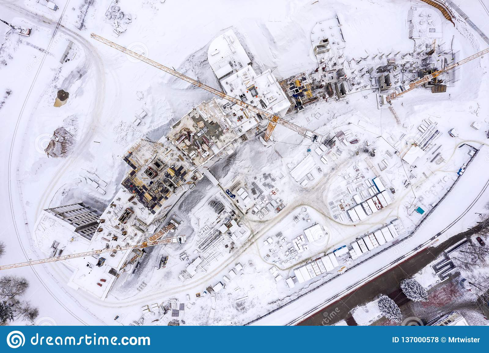 Aerial top view of construction site in winter. building of new residential area