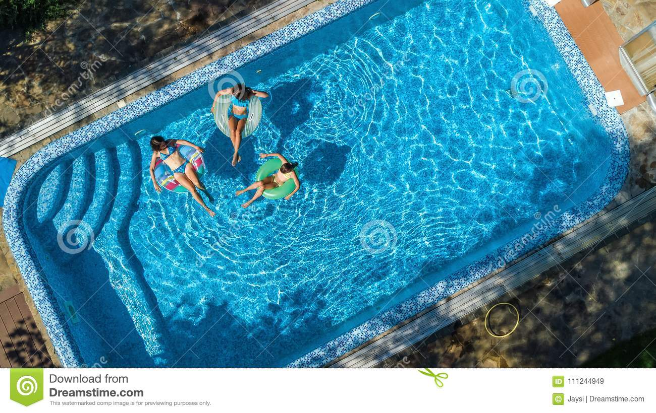 Aerial Top View Of Family In Swimming Pool From Above