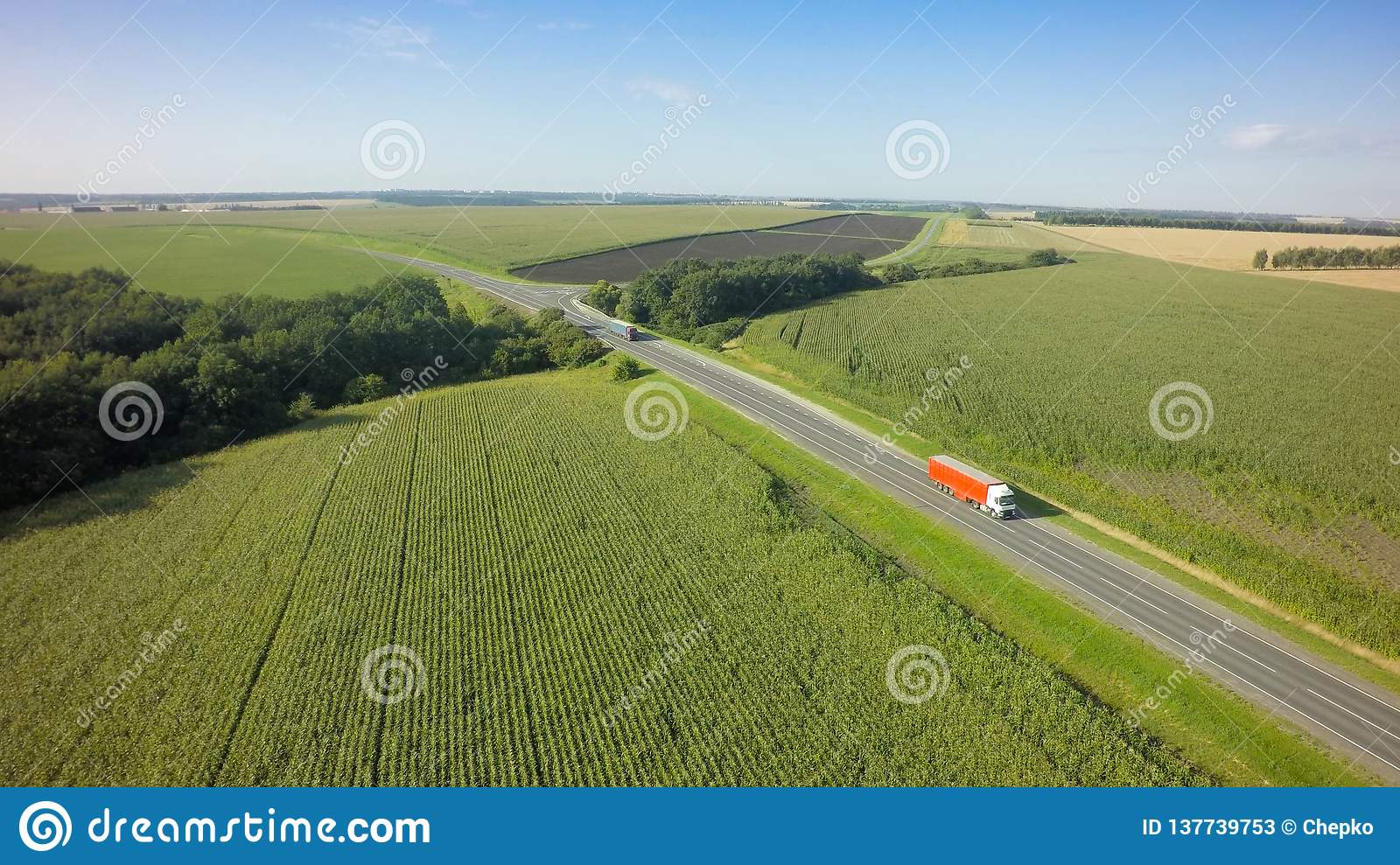Aerial Top View of White Truck with Cargo Semi Trailer Moving on Road in Direction