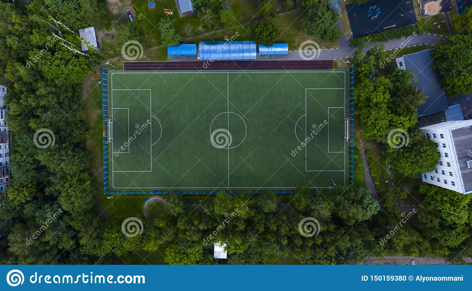 Aerial urban view of the football field with players