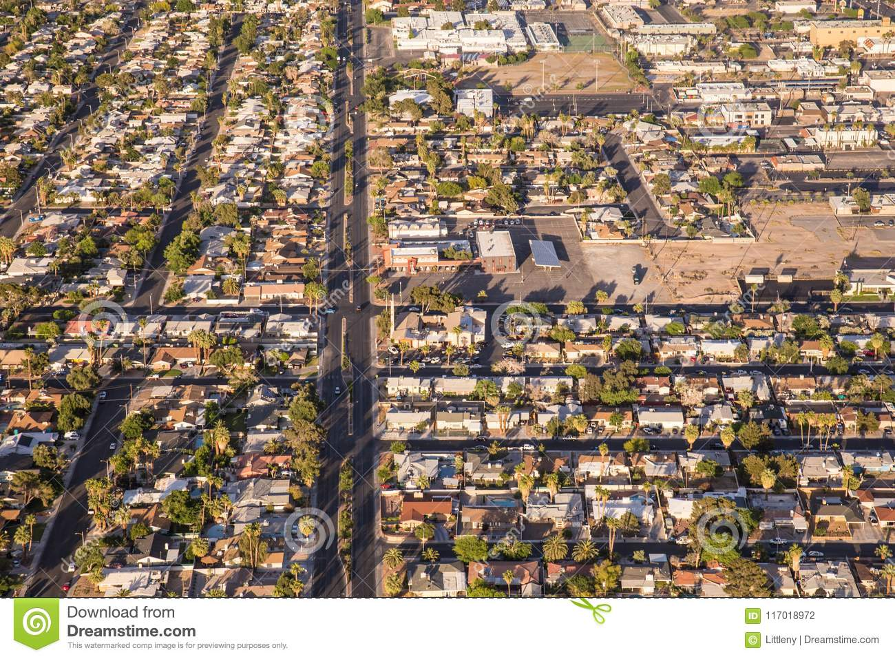 aerial view across urban suburban communities seen from las vegas nevada with streets rooftops and homes