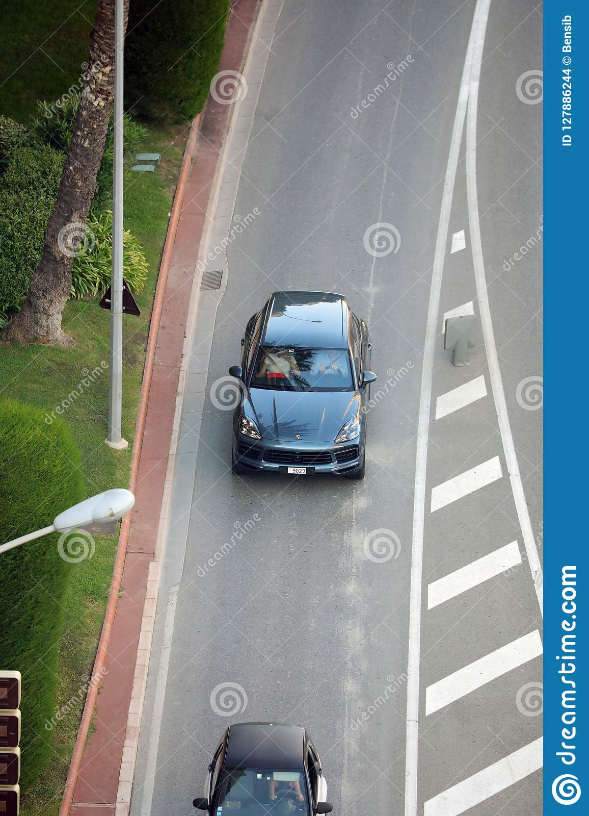 Aerial View Of A Beautiful Porsche Cayenne SUV Driving On