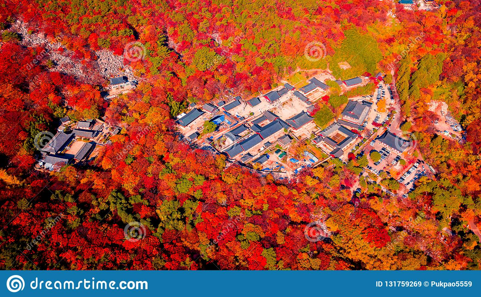 Aerial view of Beomeosa temple in Busan South korea.Image consists of temple located between the mountain covered with colorful