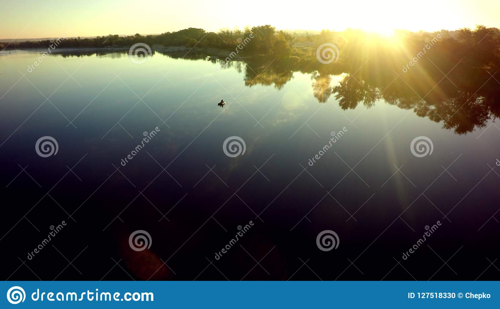 Aerial view of a boat traveling on the water. Ruber Boat drone p