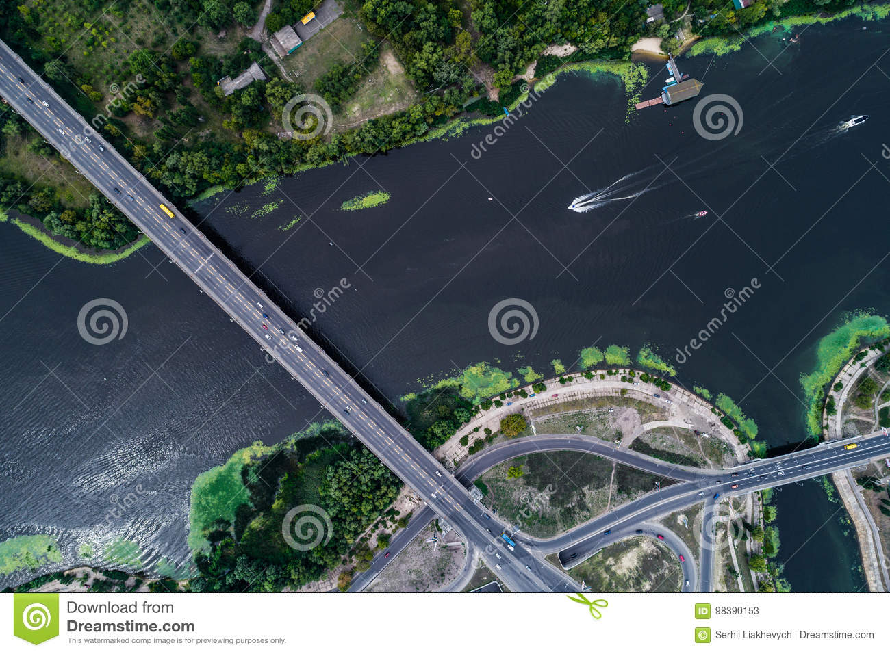 Aerial view of the bridge and the road over the Dnepr River over a green island in the middle of the river