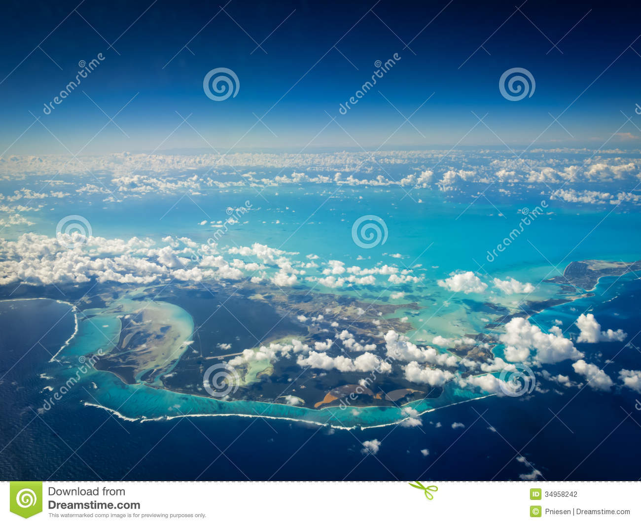 Aerial view of bright turquoise shallow water around Caribbean islands