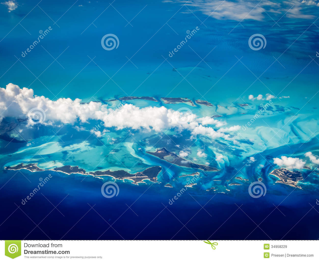 Aerial view of Caribbean Bahamas islands rising in a turquoise sea