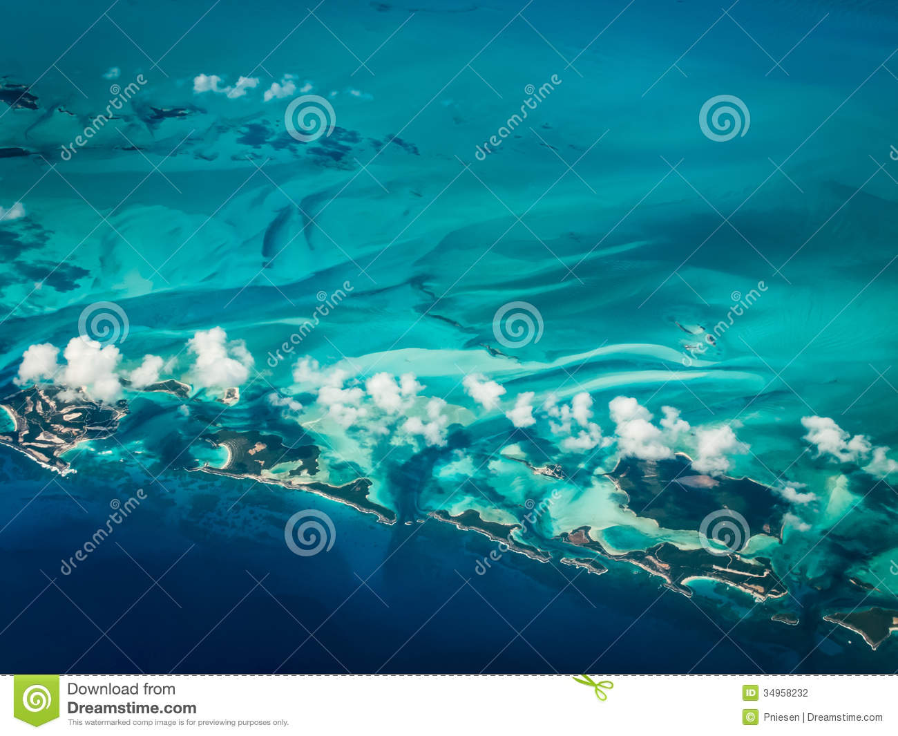 Aerial view of Caribbean islands surrounded by greenish turquoise of water near barrier reefs