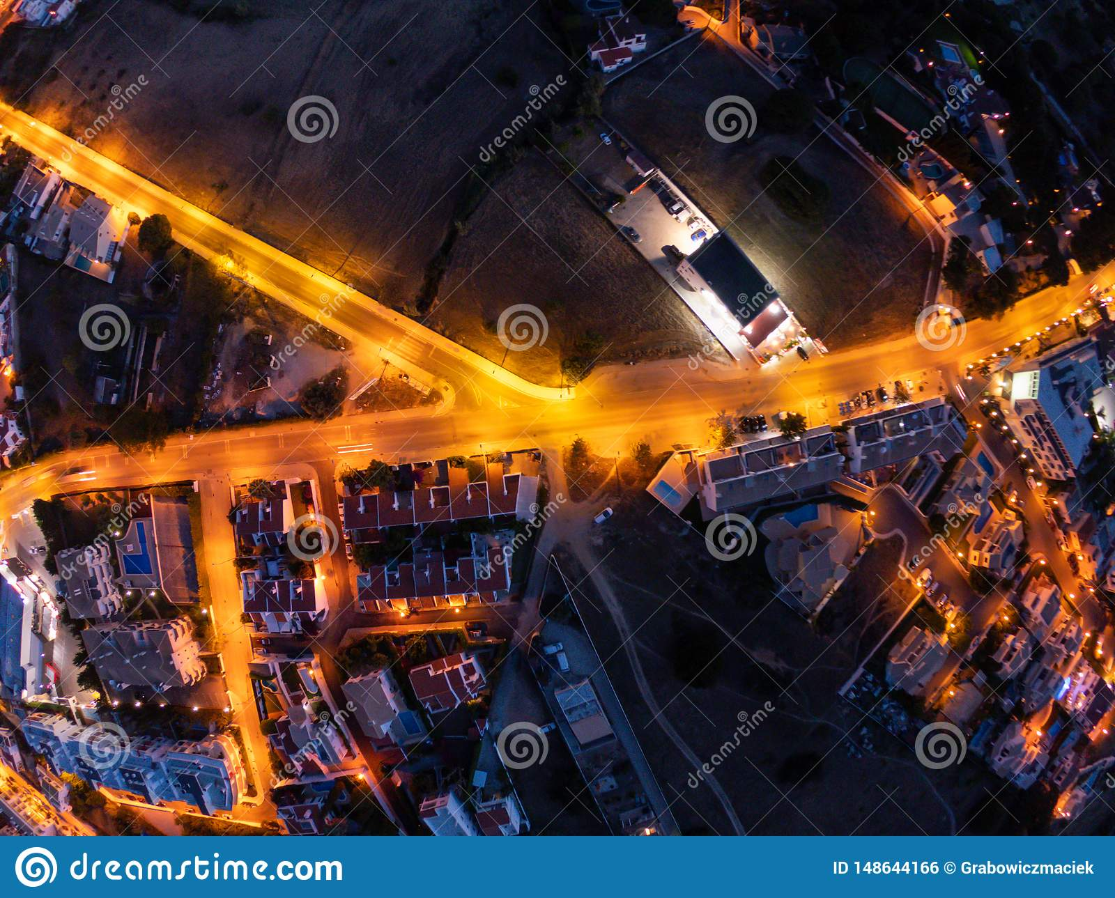 Aerial view on City at night, Albufeira, Portugal. Illuminated streets at sunset