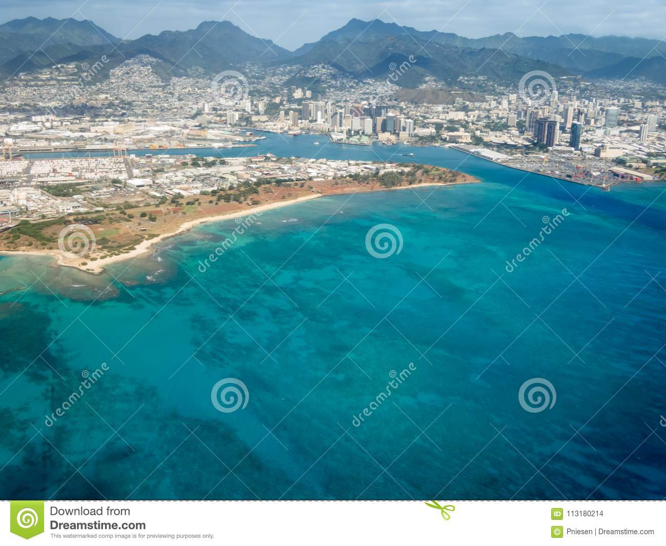 Aerial view of mountains, city, and ocean at Honolulu, Hawaii