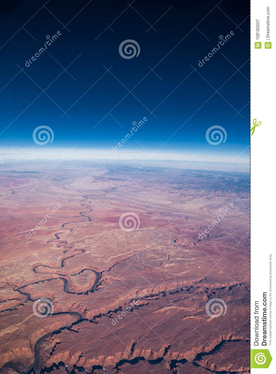 Aerial View Of Curvature Of Earth Across Red Desert Stock Image