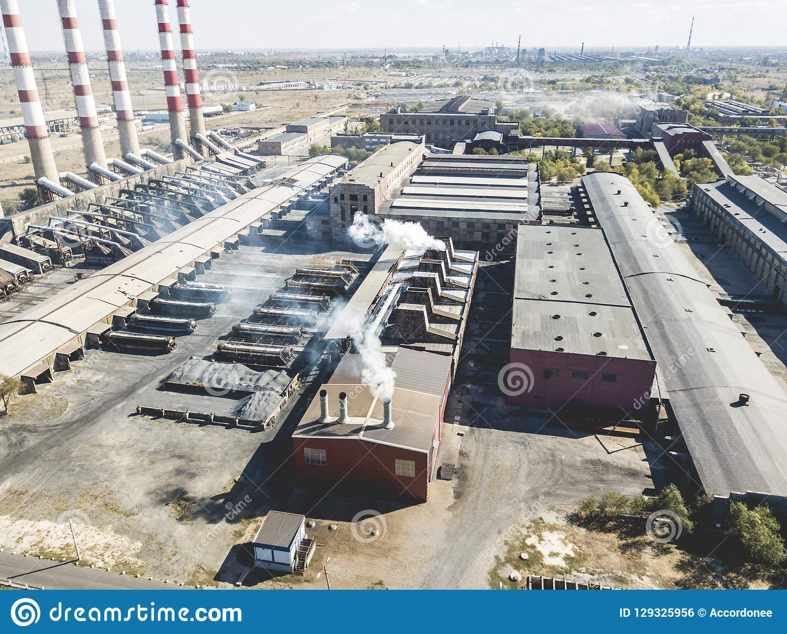 Aerial view of factory pipes emit smoke with harmful substances, air pollution f