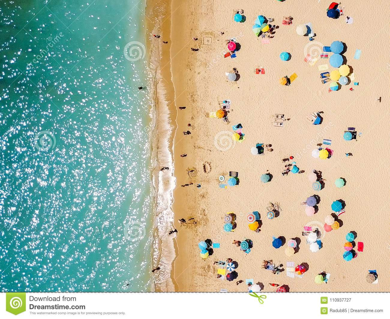 Aerial View From Flying Drone Of People Crowd Relaxing On Beach