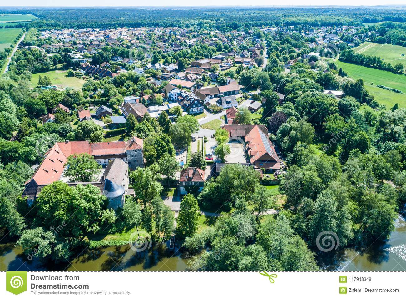 Aerial View Of A German Village With A Small Forest A Pond And A