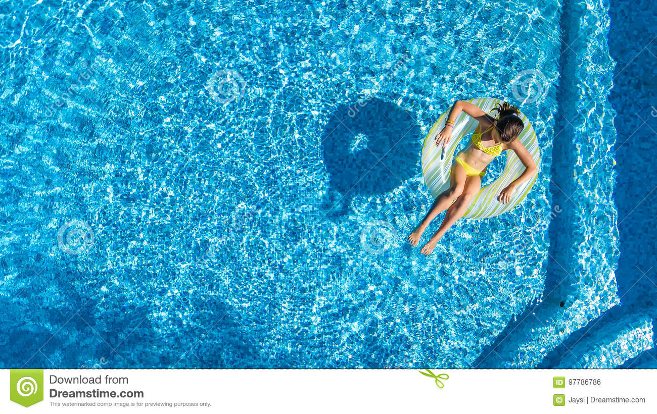 Aerial view of girl in swimming pool from above kid swim - Wetherby swimming pool swim times ...