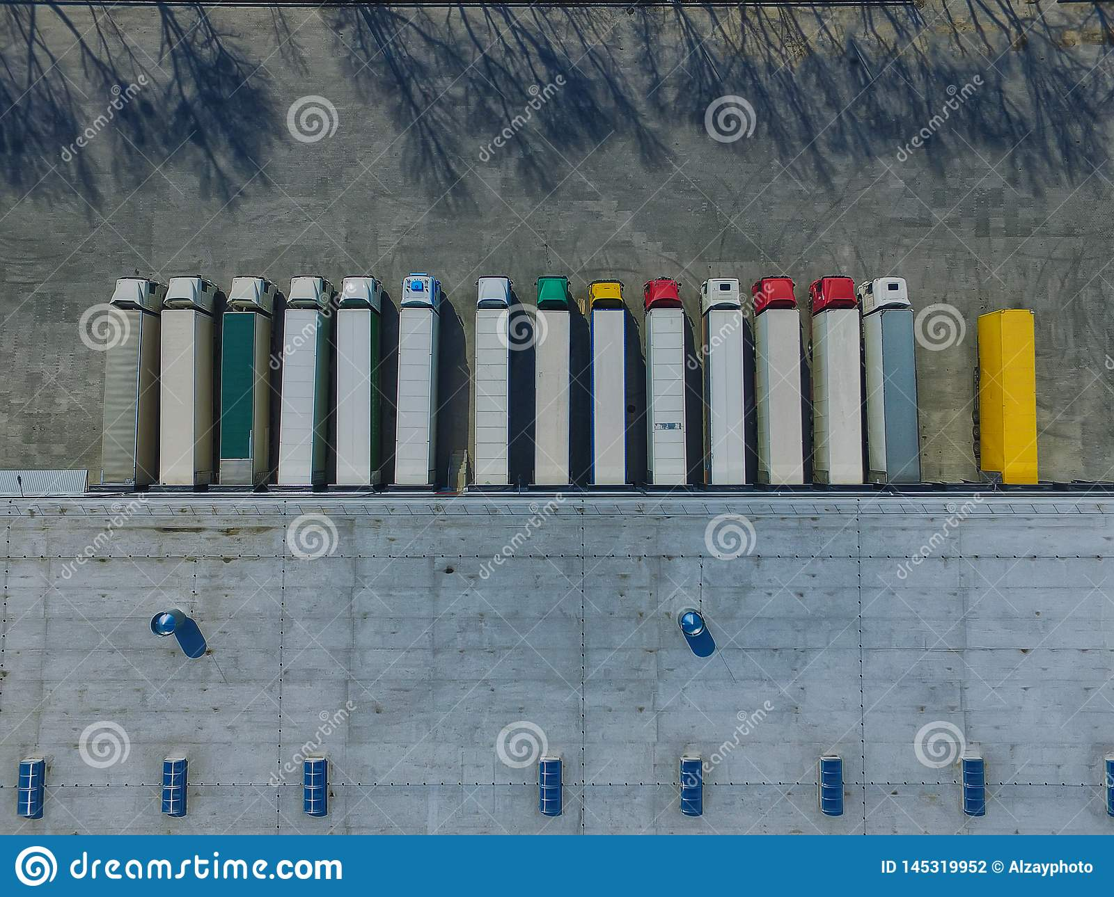 Aerial view of goods warehouse. Logistics center in industrial city zone from above.