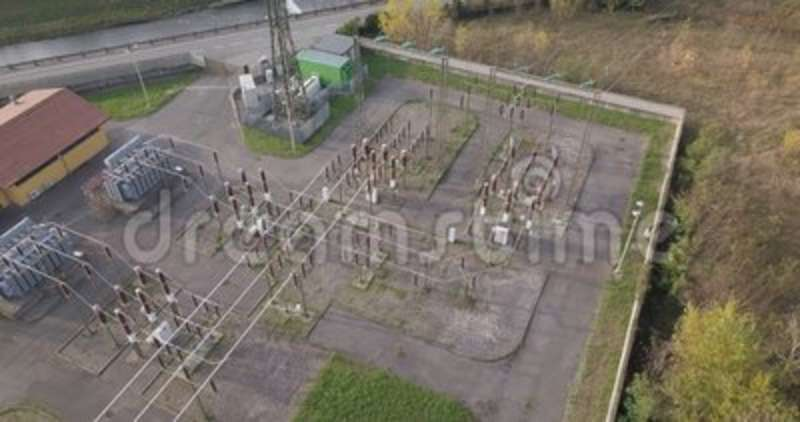 Electric Plant Aerial View. Aerial view of a high voltage power substation on an autumn morning stock video