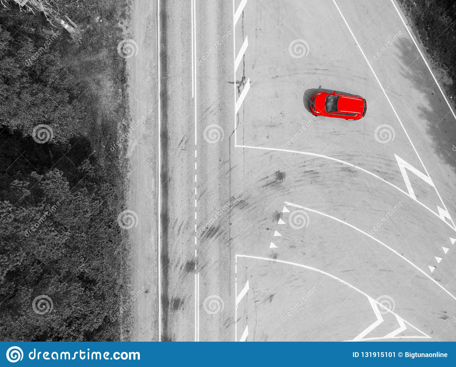 Aerial view of highway. Aerial view of a country road with moving red car. Car passing by. Aerial road. Aerial view flying. Captur