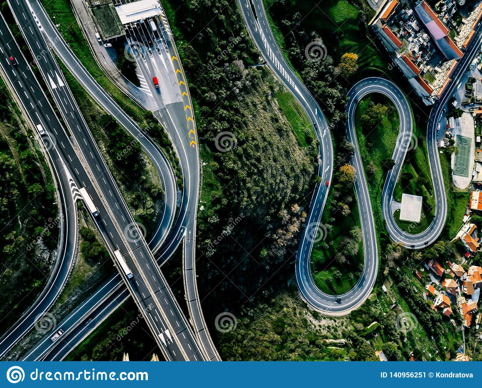 Aerial view of highway, expressway and motorway with a toll payment point in Italy