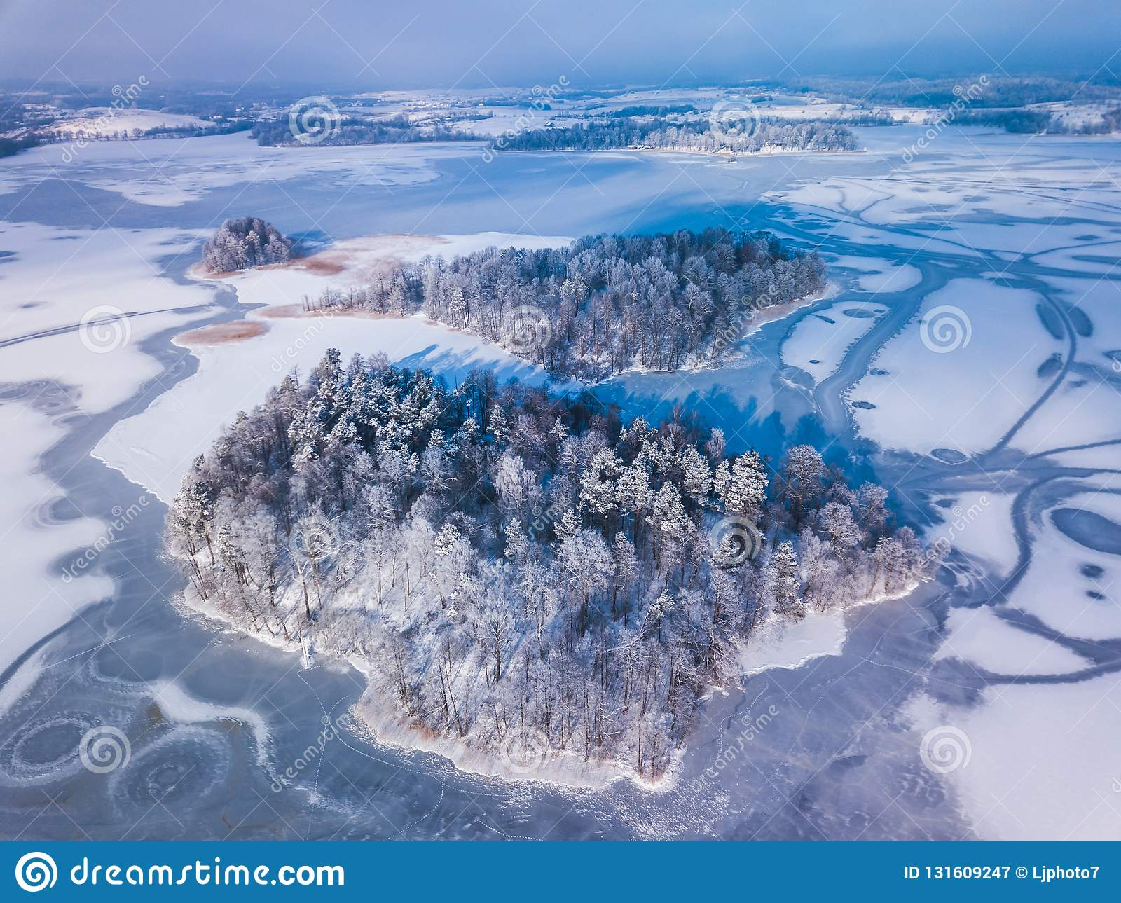 Aerial View Of The Winter Snow Covered Forest And Frozen