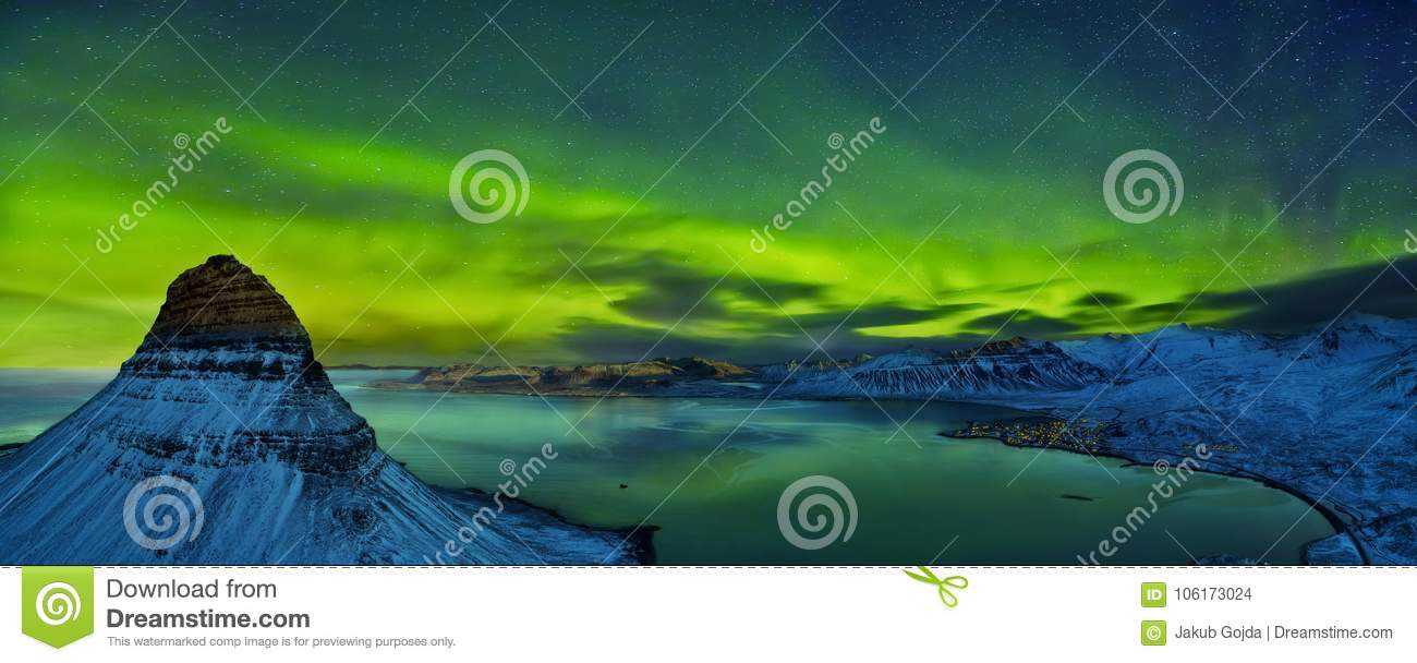 Aerial view of Kirkjufell mountain with beautiful aurora borealis in winter, Iceland.