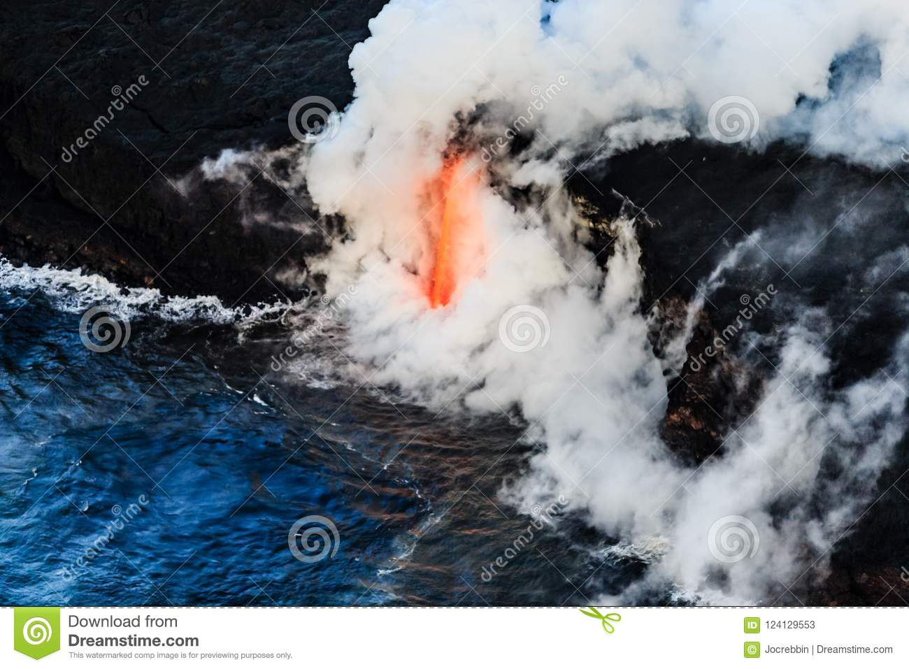 Aerial view of lava flowing into the Ocean off Hawaii