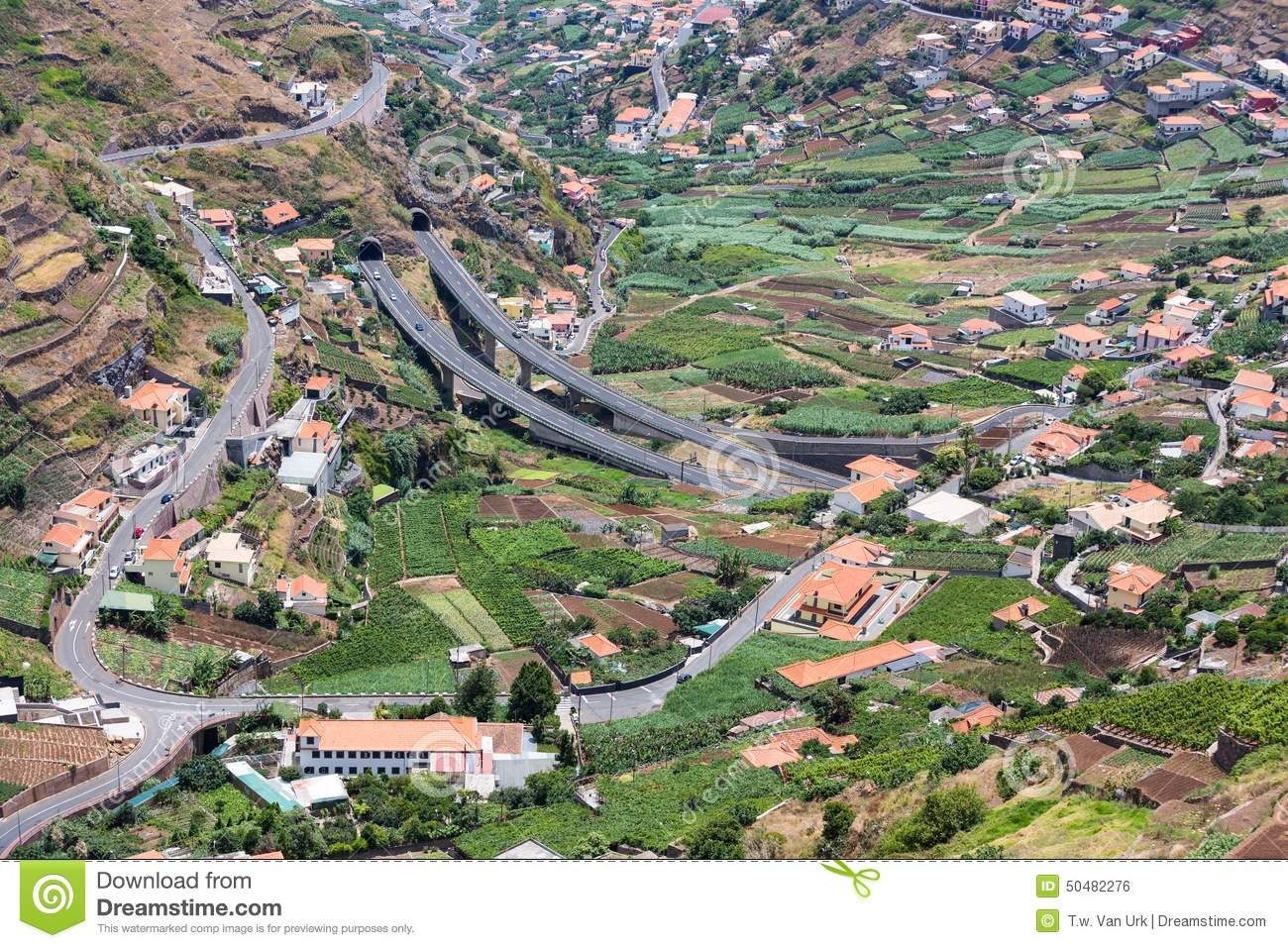 Aerial view of little villages and a highway in the mountains of Madeira Island