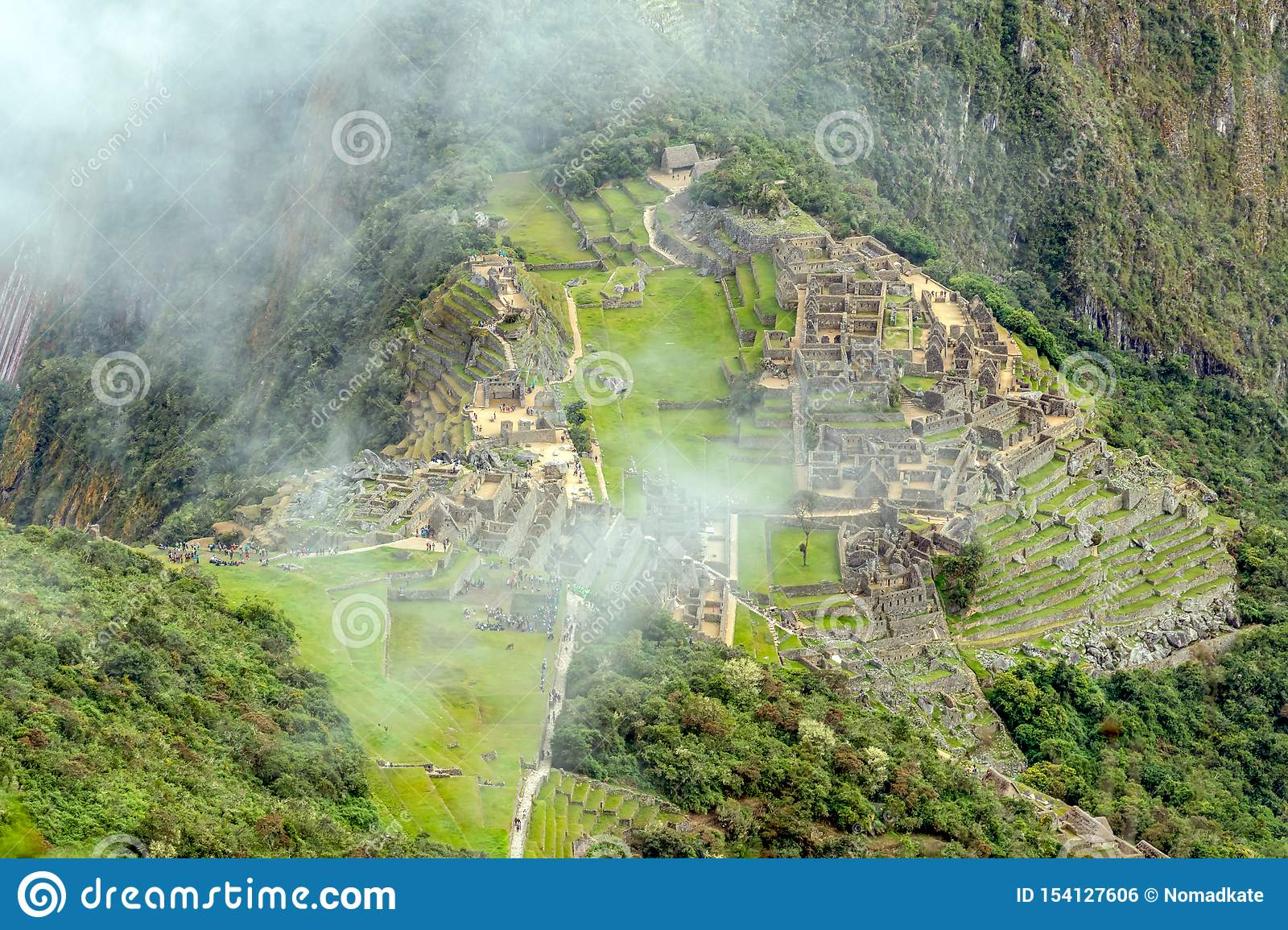 Aerial view of Machu Picchu Inca citadel ruins built in the classical Inca style, with polished dry-stone walls