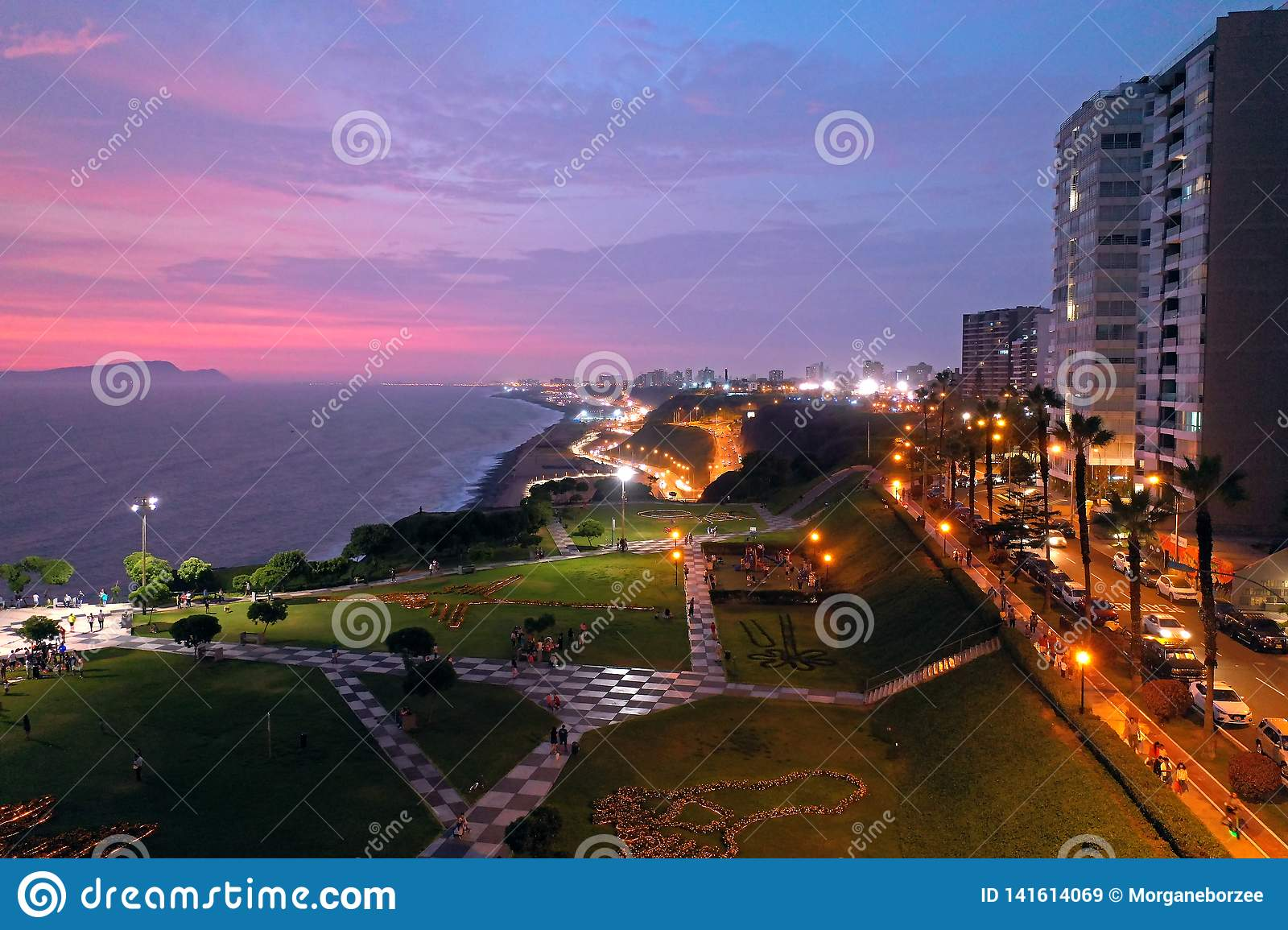 Aerial view of Maria Reiche Park at sunset with scenic seascape