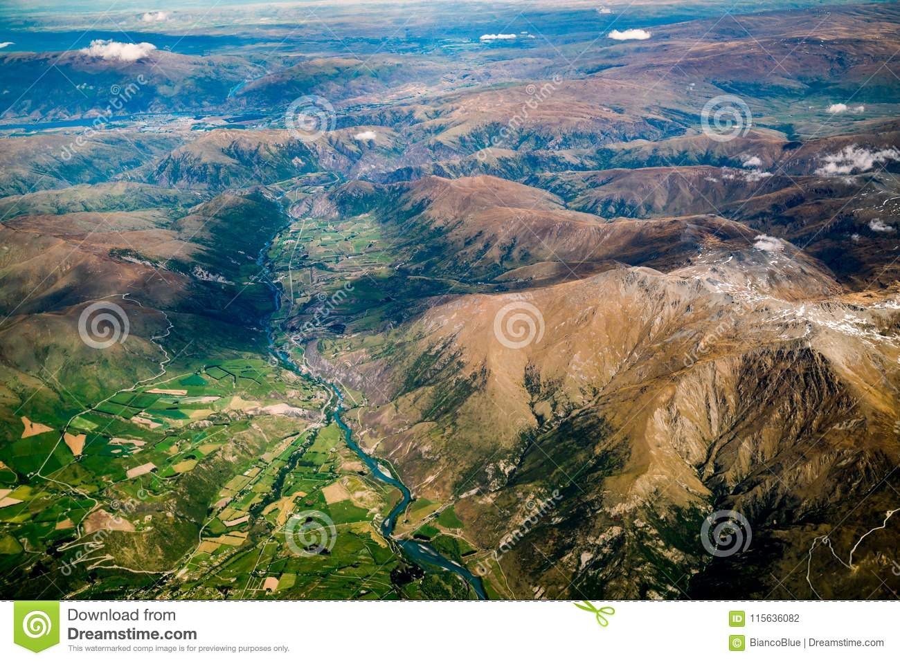 Aerial view of mountain ranges and lake landscape