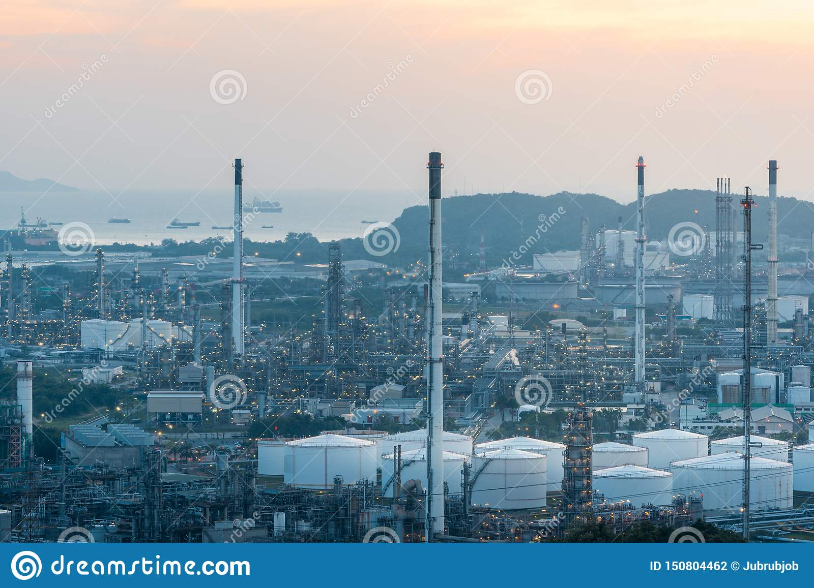 Aerial view of Oil and gas industry - refinery at sunset - factory - petrochemical plant, Shot from drone of Oil refinery and