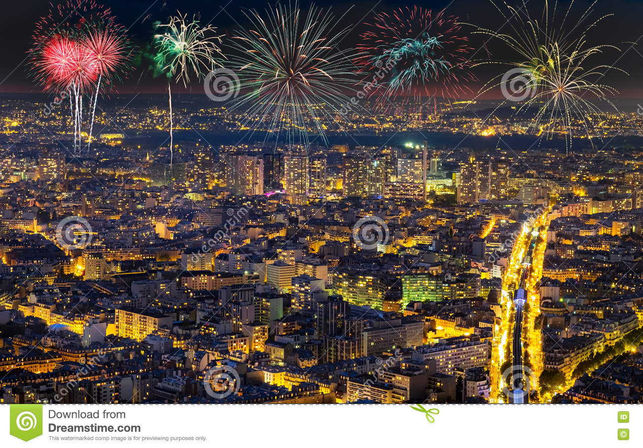 Aerial view of Paris, France with fireworks in the sky.