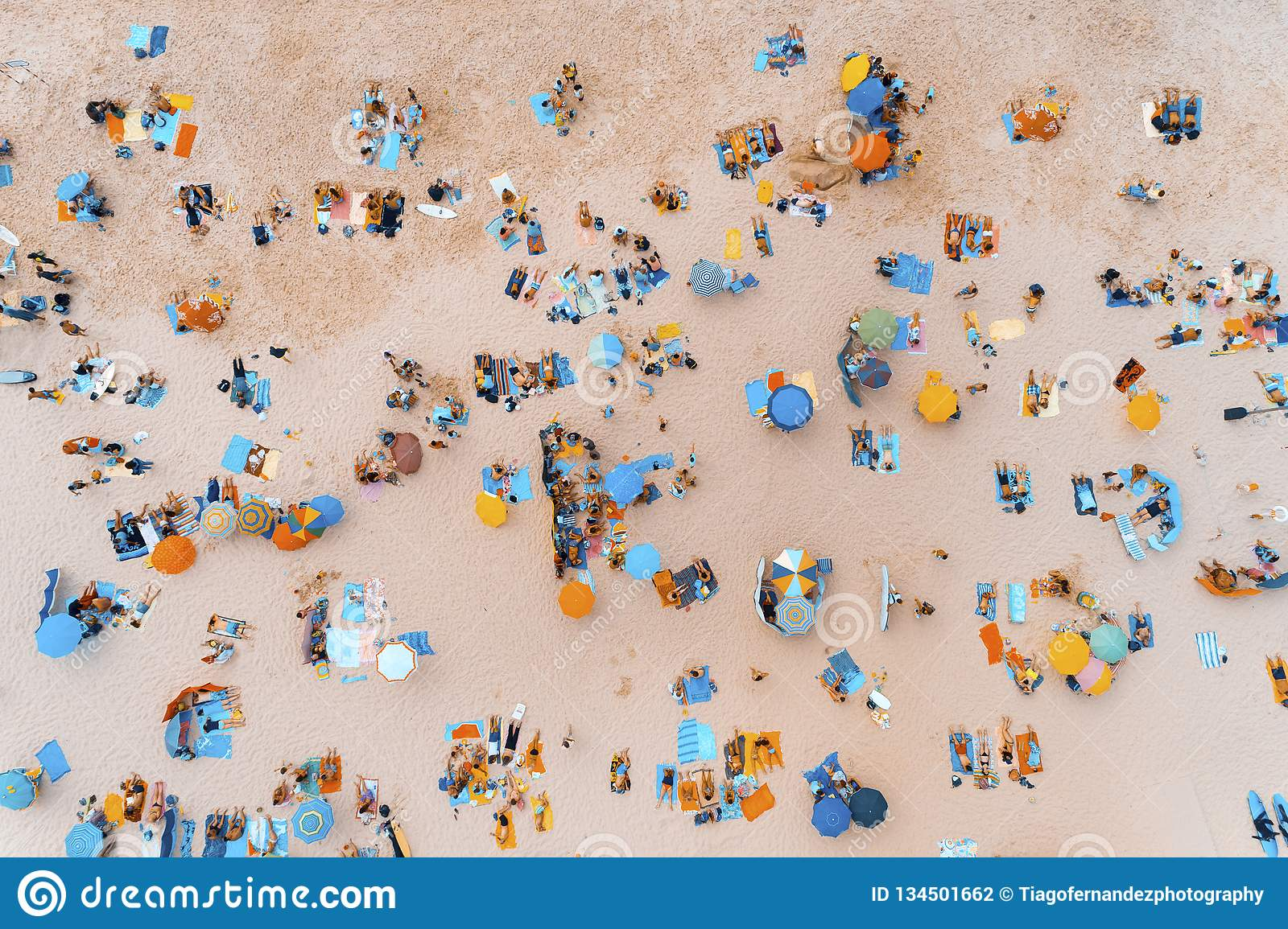 Aerial View Of People Sunbathing At A Beautiful Beach In ...