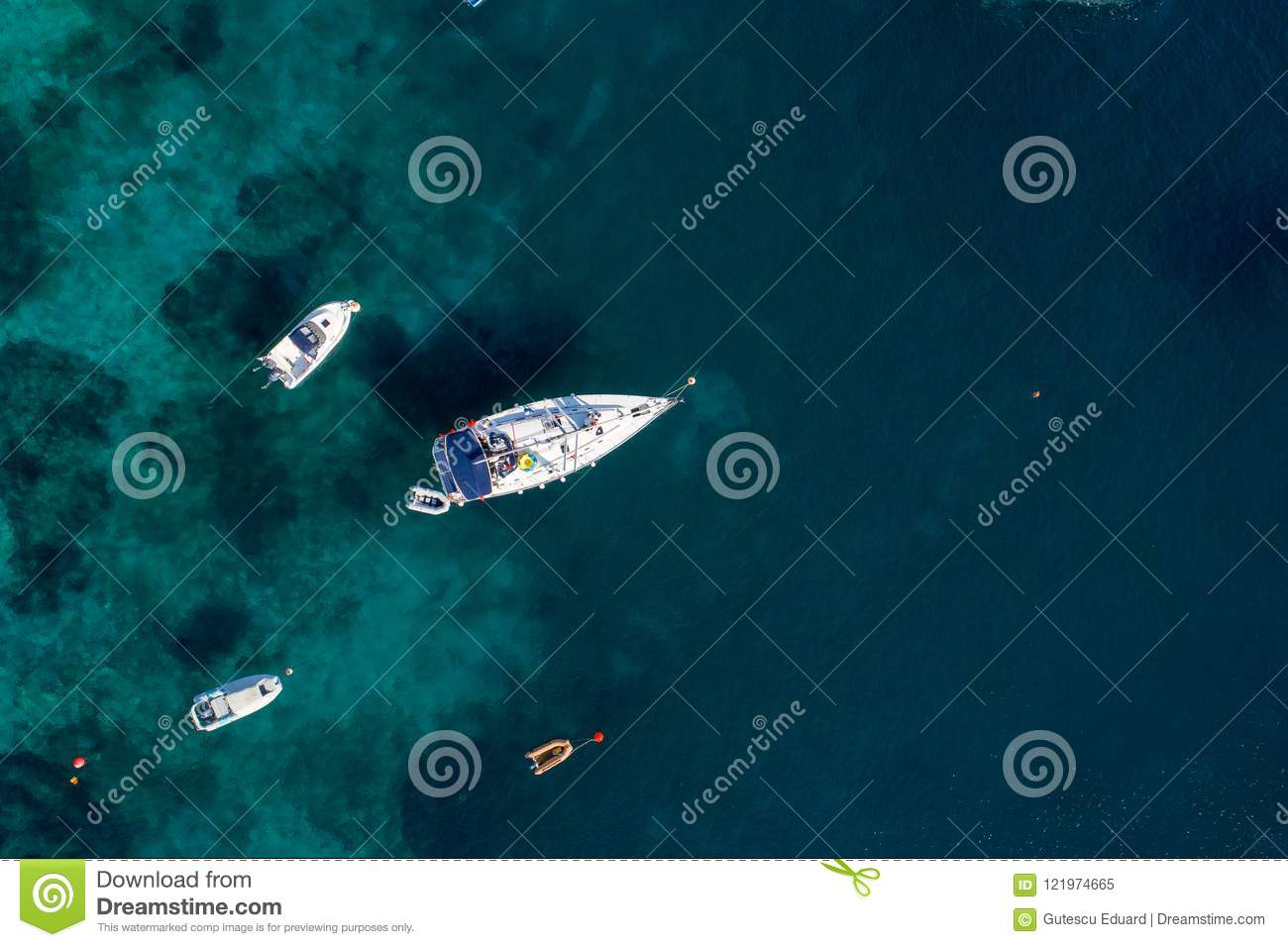 Aerial view of sailing boat on Aegean sea on Greece