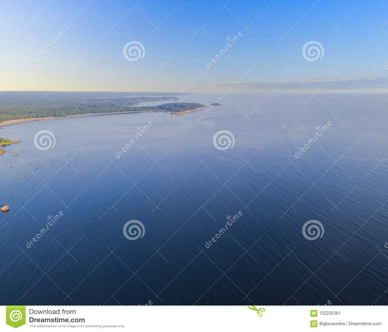 Aerial view of seashore with beach, lagoons and coral reefs. Coastline with sand and water. Tropical landscape. Aerial photography