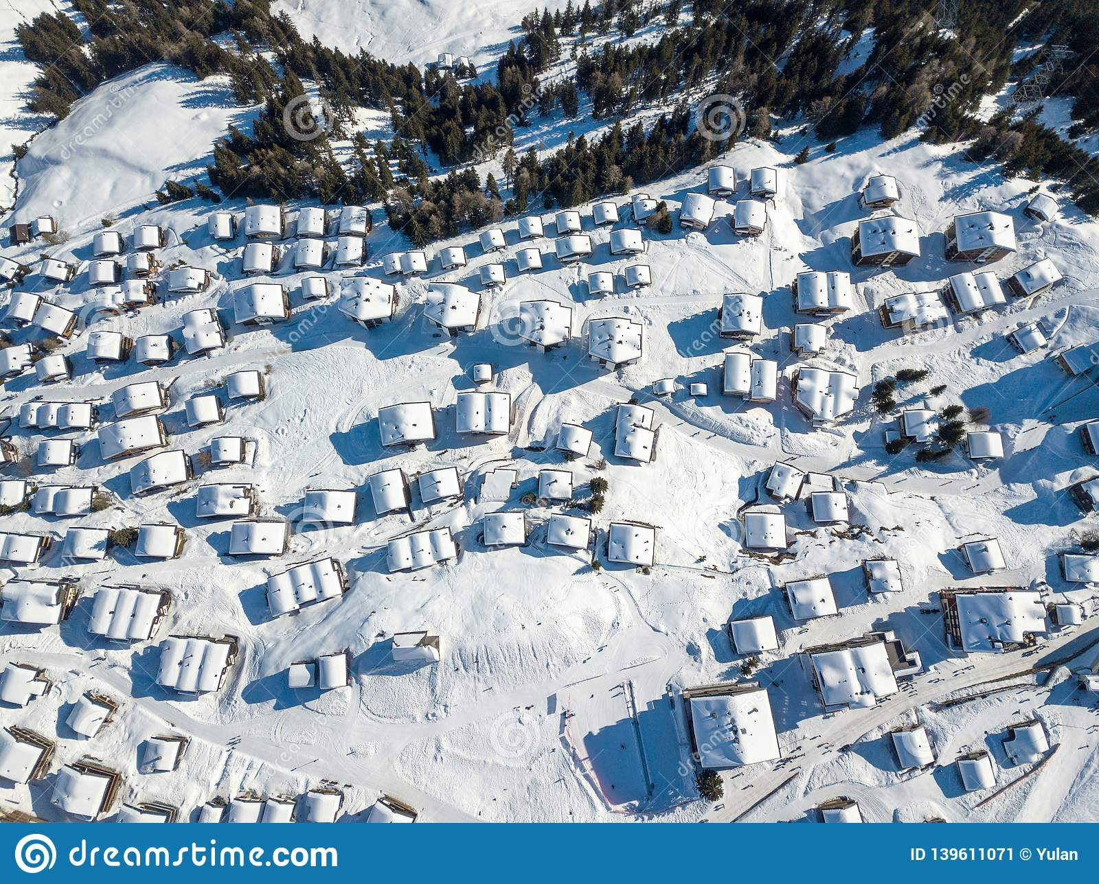 Aerial view of snow covered roofs over the traditional chalets