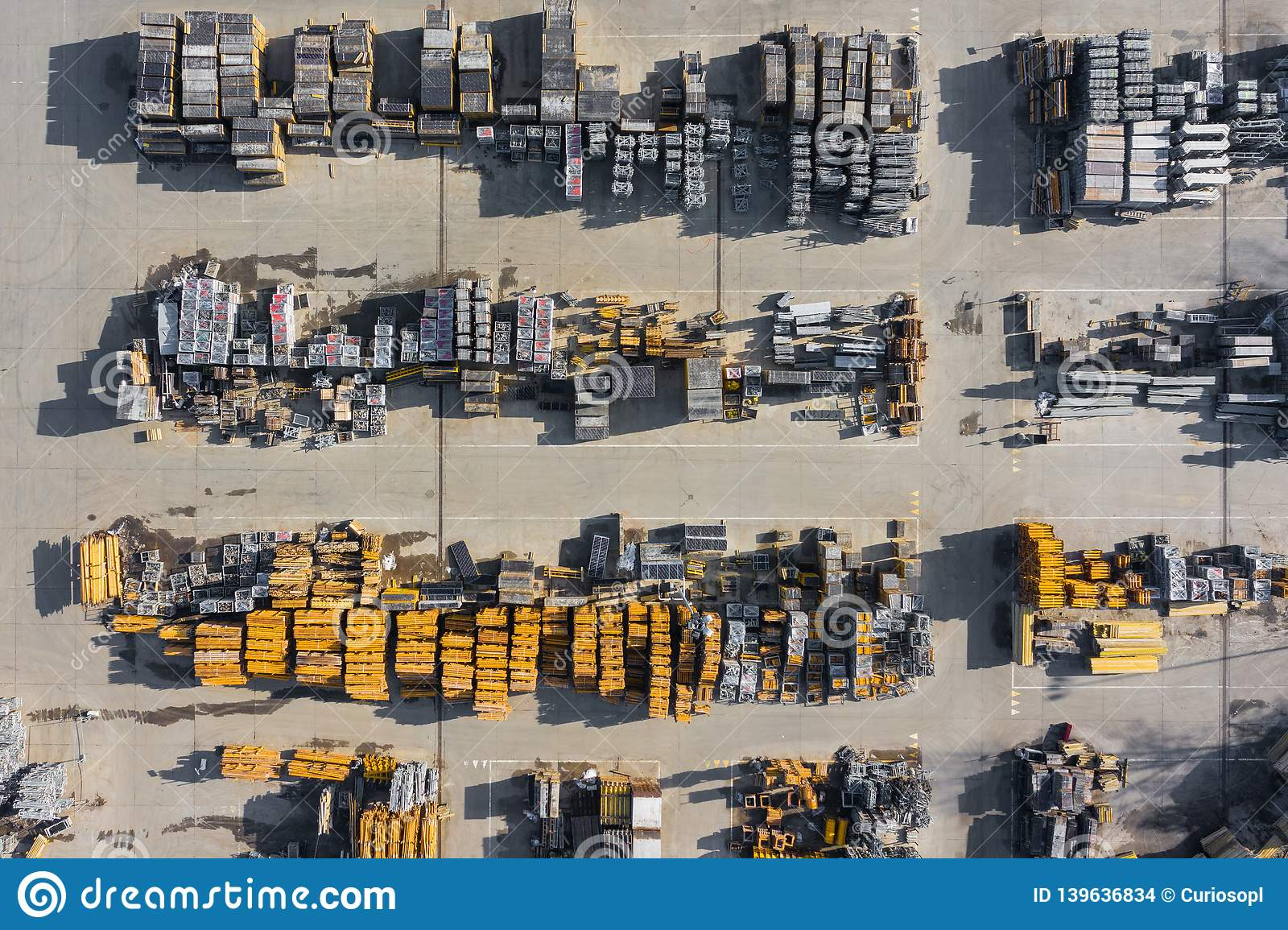 Aerial view of storage place. Construction materials in industrial city zone from above. Top view. Photo captured with drone