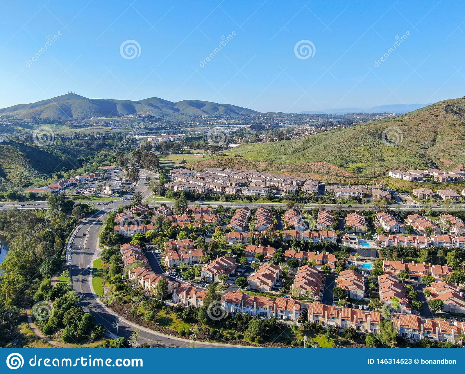 Aerial view suburban neighborhood with identical villas next to each other in the valley. San Diego, California,