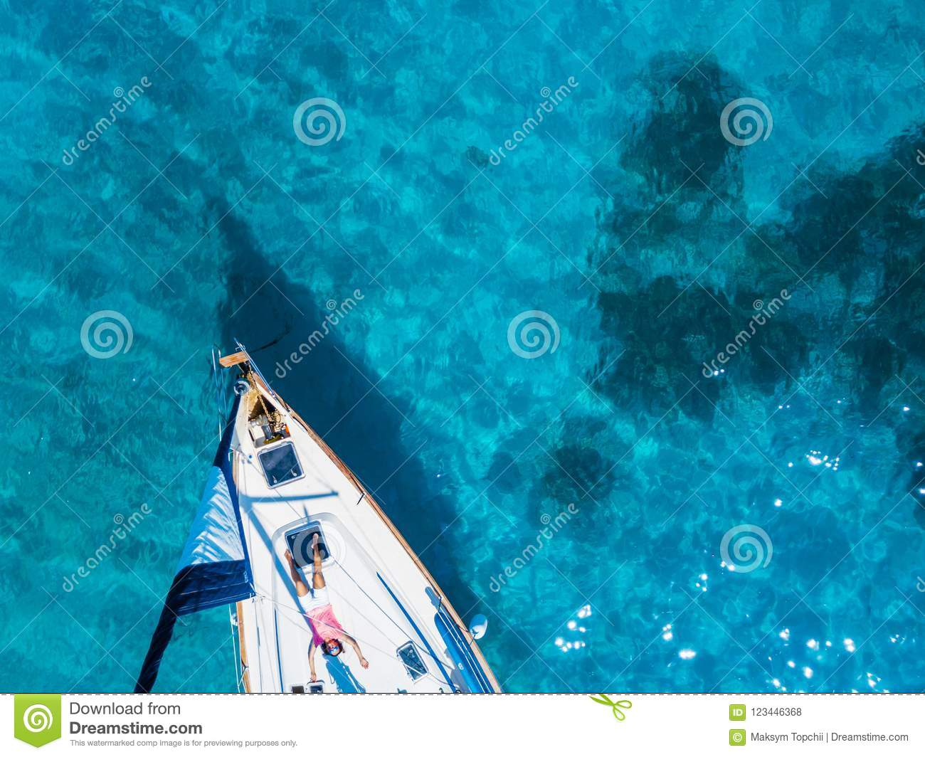 Download Aerial View To Yacht In Deep Blue Sea Drone Photography Stock Photo