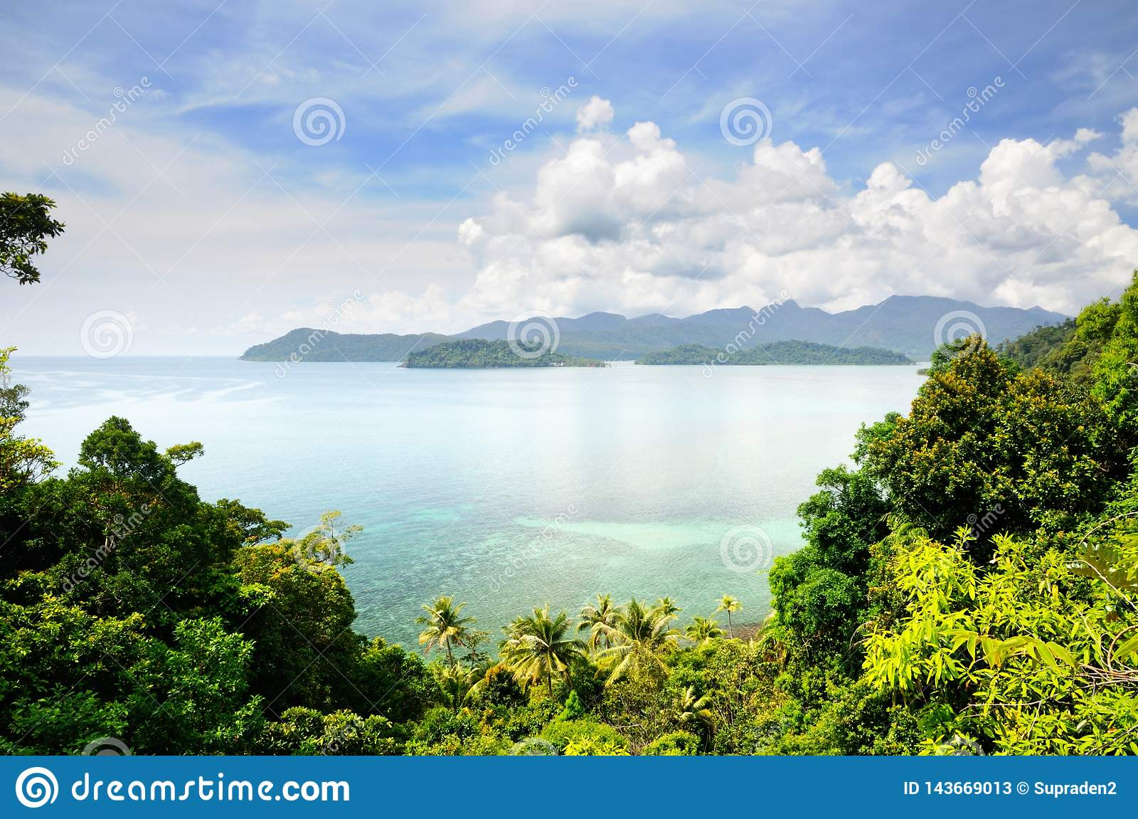 Aerial view on the tropical island, turquoise sea, mountains, blue sky and scenic clouds at the Koh Chang island, Thailand.