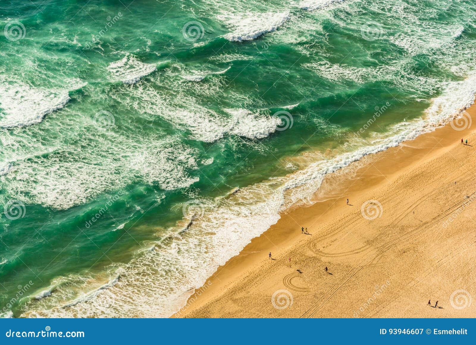 Aerial view of tropical sandy beach ans sea, ocean waves