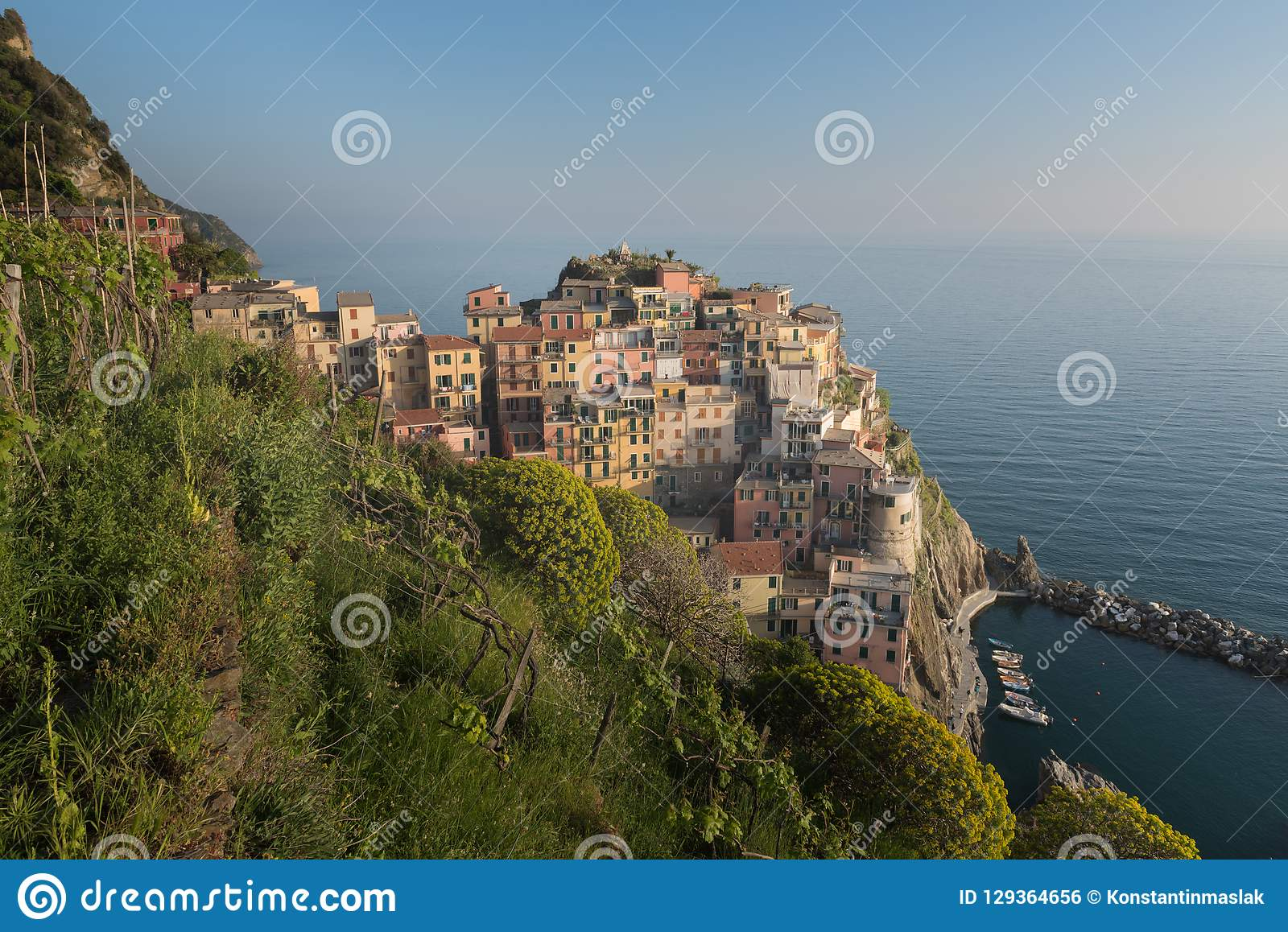 Aerial view of Vernazza fishing village at sunset, seascape in Five lands, Cinque Terre National Park
