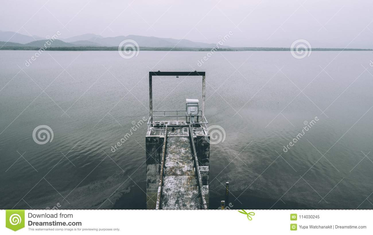 Aerial View Of Water Level Gate Used In Small Lake Dam For