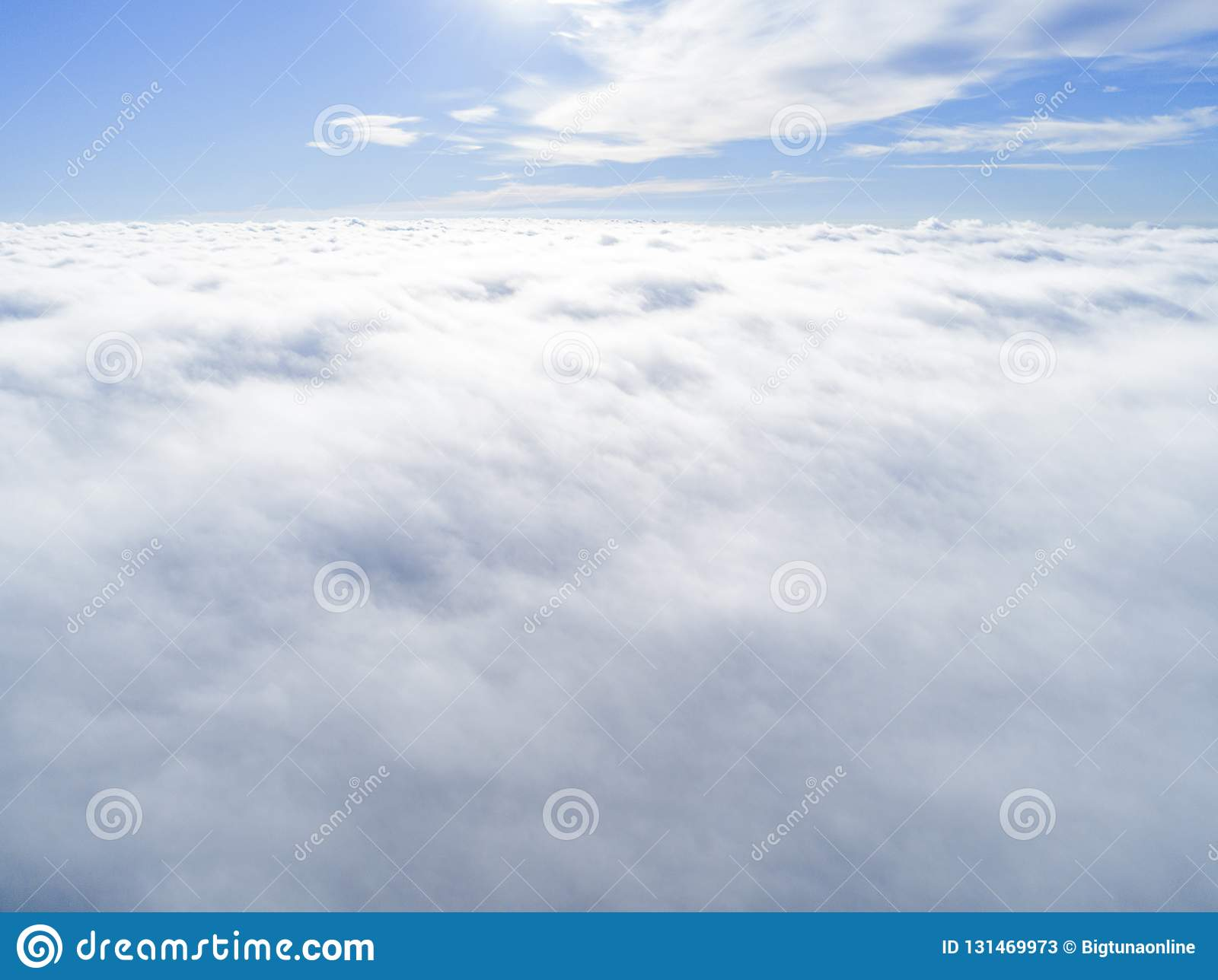 Aerial view White clouds in blue sky. Top view. View from drone. Aerial bird`s eye view. Aerial top view cloudscape. Texture of cl