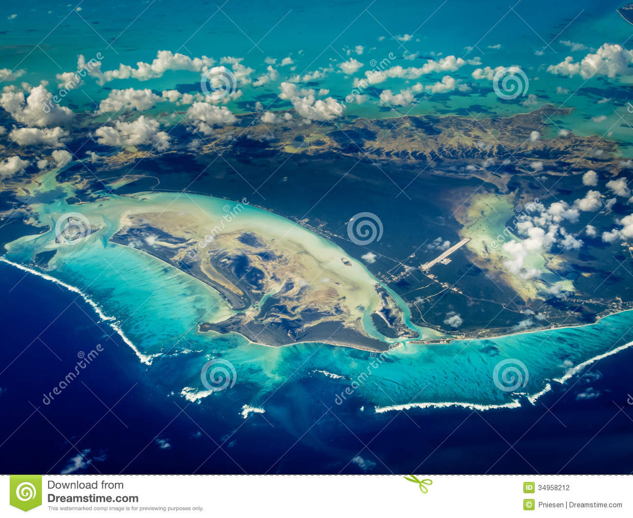 Aerial view of white lines of waves border Caribbean islands
