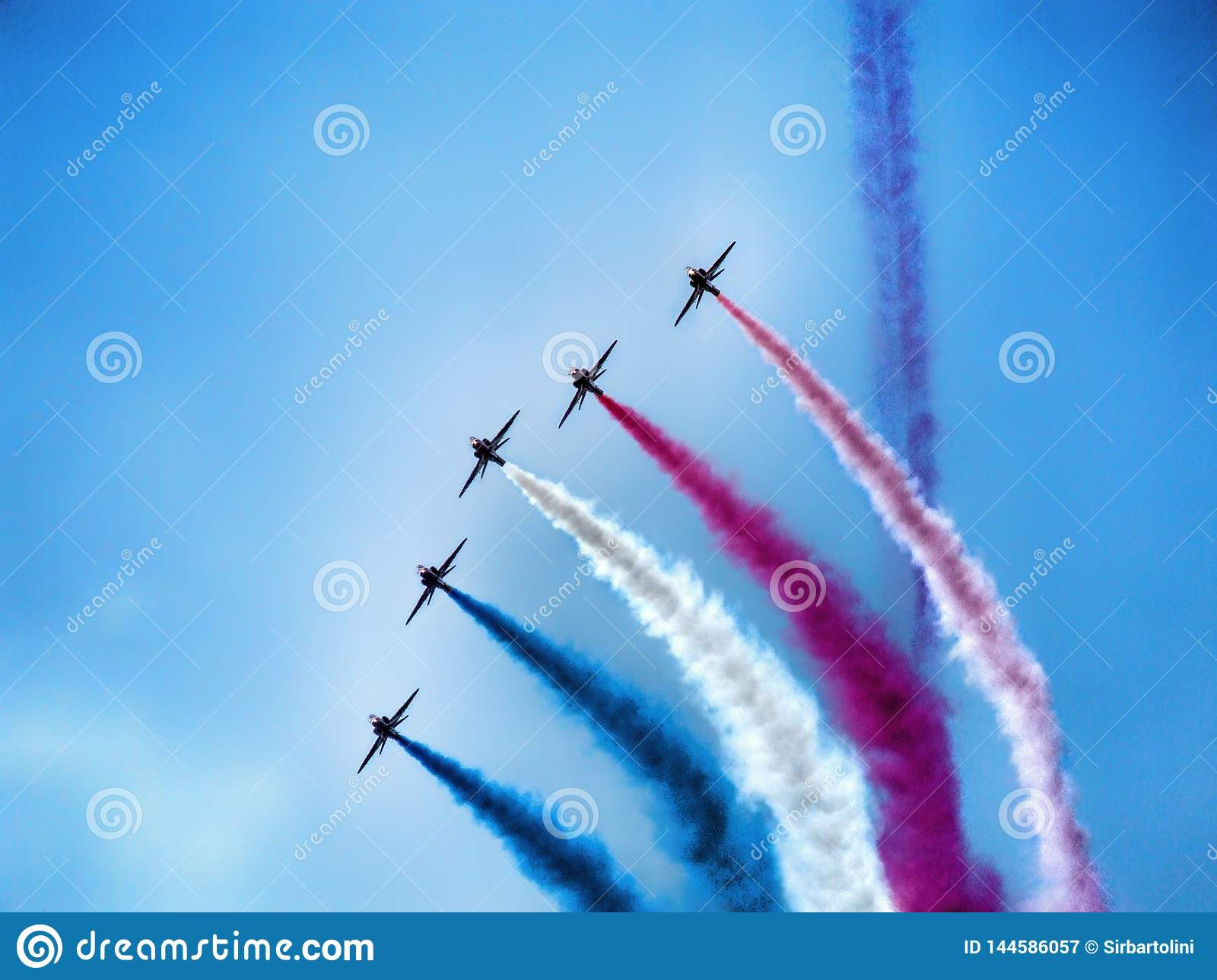 Four military training jet aircraft in aerobatic team.