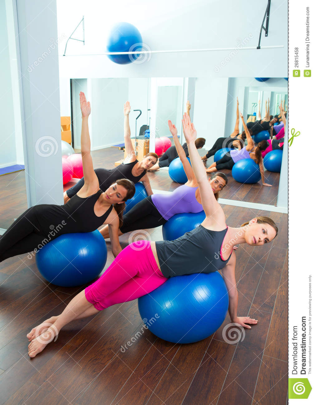 Aerobic pilates women group with stability ball stock for Gimnasio pilates
